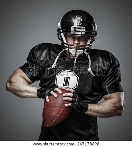 American football player with ball