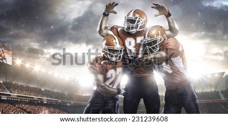 American football players in action on stadium panorama view - stock photo