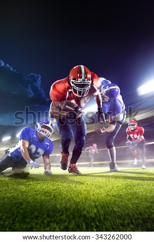 american football players in the action grand arena - stock photo