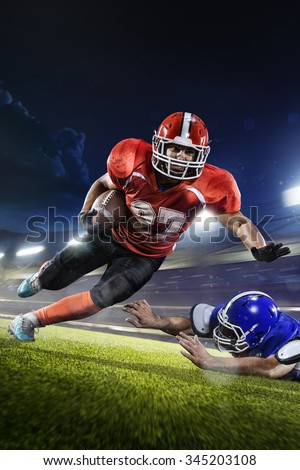 american football players in the action jn grand arena - stock photo
