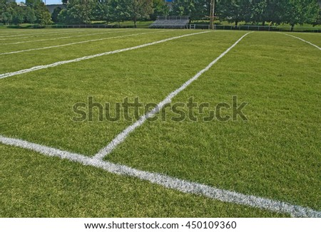 American football playing field with white boundary lines.