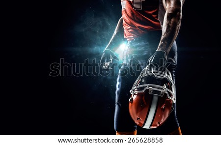 American football sportsman player in stadium - stock photo