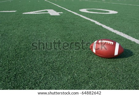 American Football with the Forty Yard Line Beyond - stock photo