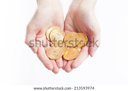 American gold coins in hands - stock photo