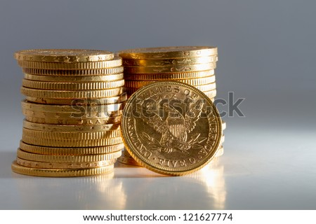 American gold dollar coins - stock photo