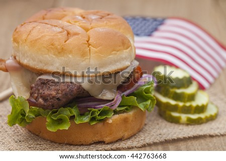 American grilled hamburger with USA flag. 4th of July. Independence day.