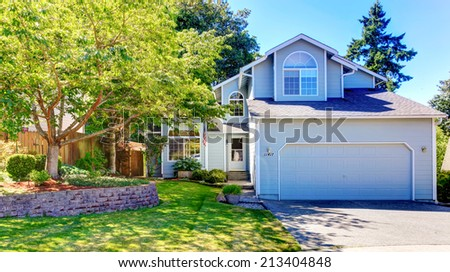 American house with garage  and driveway.  Landscape design idea for front yard - stock photo