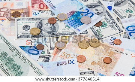 American hundred dollar bills and different Euro bills on background.