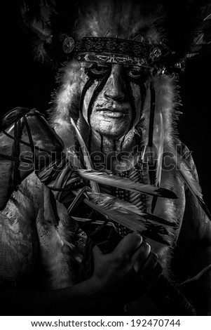 American Indian chief with big feather headdress, warrior - stock photo