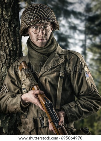 American infantry officer with rifle in hands of the Second World War on background of field