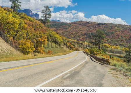 American landscape long asphalt mountain road in beautiful sunny autumn weather in the USA