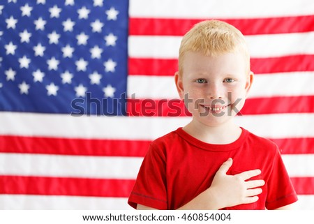 American little boy with American flag on a background