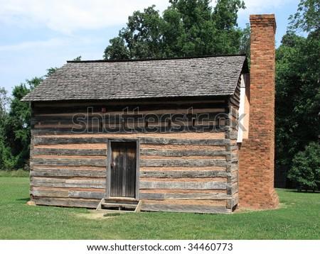 American Log Cabin - James Polk State Historic Site - stock photo