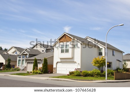 American luxury suburbs home with blue sky and clouds - stock photo