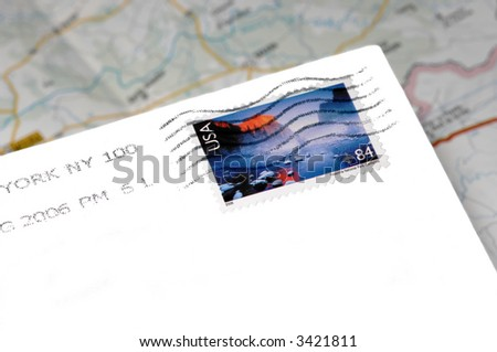 American mail with stamp envelope over of map - stock photo