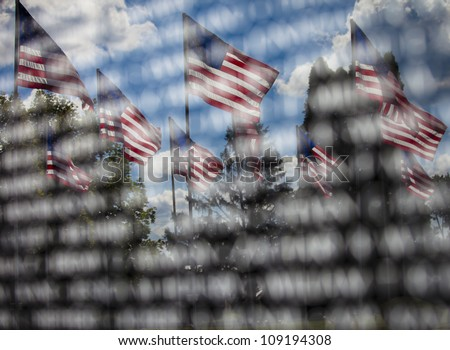 American memorial, the reflection of American Flags in an engraved memorial - stock photo