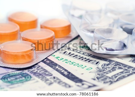 American money and empty and full packing of medicines - stock photo