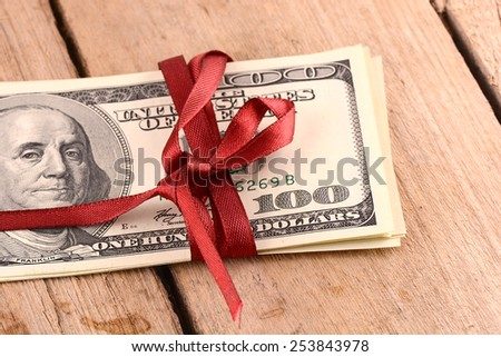 american money and red ribbon - stock photo