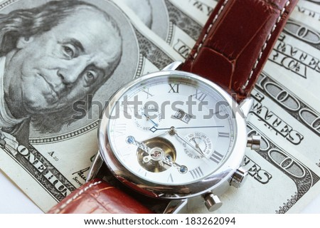 American money and wristwatch with strap, concept - stock photo