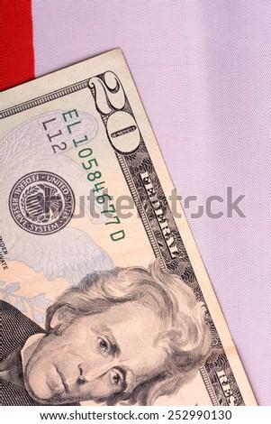 american money dollars on american flag - stock photo
