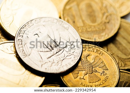 American one quarter coin on russian roubles coins - stock photo