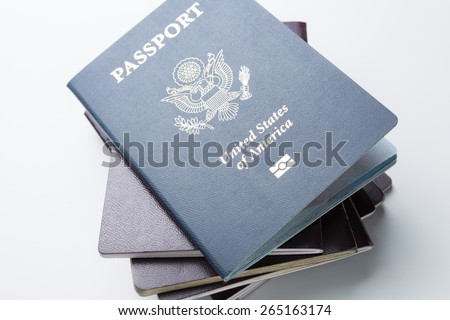 American Passport on Top of other Passports - stock photo