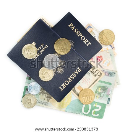 american passports on top of multinational currencies on a white background