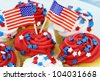American patriotic themed cupcakes for the 4th of July.  Shallow depth of field. - stock photo