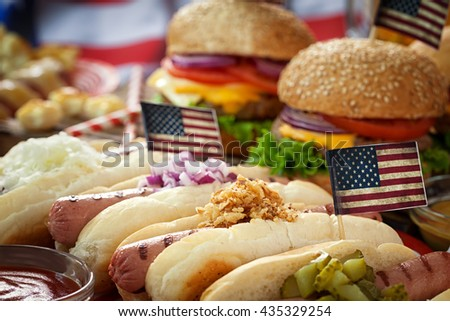 American  Picnic Table  with burgers and hot dogs for holiday 4th of July  - stock photo