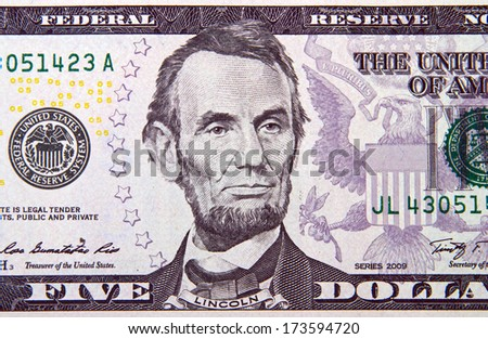 American president Lincoln on the five dollar banknote  - stock photo