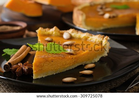 American pumpkin pie with cinnamon and nutmeg - stock photo