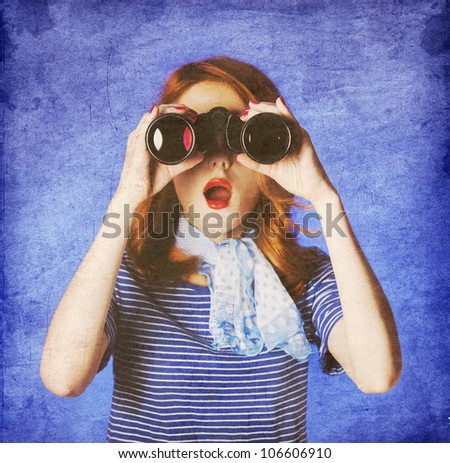American redhead girl in suglasses with binocular. Photo in 60s style. - stock photo