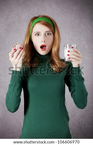 American redhead girl with milk and cake. Photo in 60s style. - stock photo