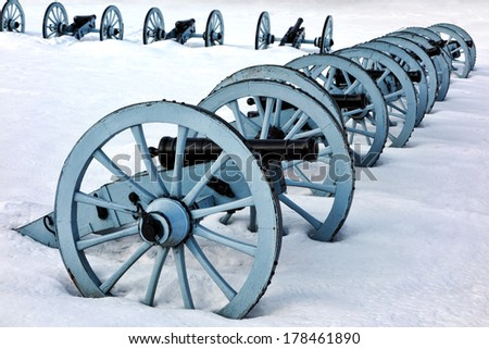 American Revolutionary War cannons defense battery artillery formation in winter snow at Valley Forge National Historical Park military camp of the Continental Army near Philadelphia in Pennsylvania  - stock photo