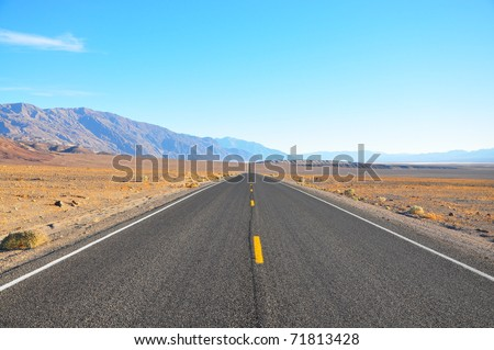 American Road through Death Valley - stock photo