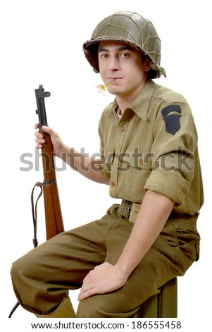 American soldier and his M1 garand with a flower in her mouth