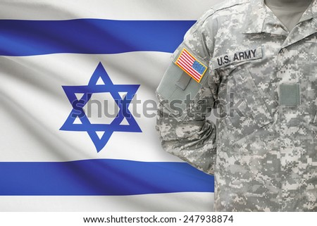 American soldier with flag on background - Israel - stock photo