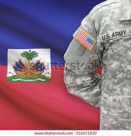 American soldier with flag on background series - Haiti