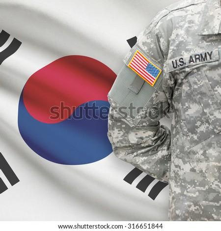 American soldier with flag on background series - South Korea - stock photo