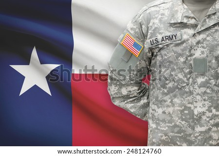 American soldier with flag on background - Texas - stock photo