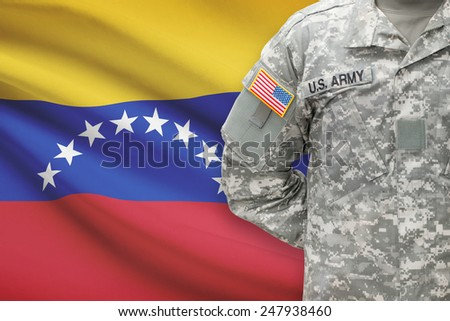 American soldier with flag on background - Venezuela - stock photo