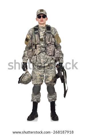 american soldier with rifle and helmet in hand - stock photo