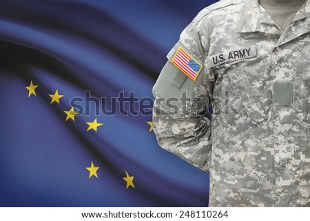 American soldier with US state flag on background - Alaska - stock photo