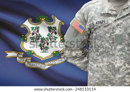 American soldier with US state flag on background - Connecticut - stock photo