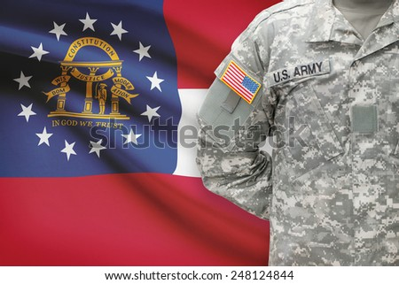 American soldier with US state flag on background - Georgia - stock photo