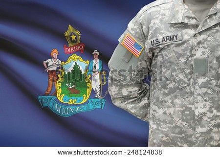 American soldier with US state flag on background - Maine - stock photo