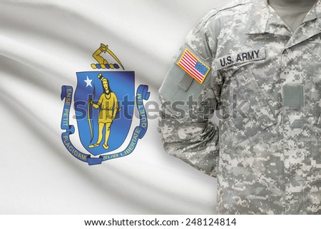 American soldier with US state flag on background - Massachusetts - stock photo