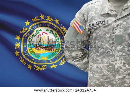 American soldier with US state flag on background - New Hampshire - stock photo