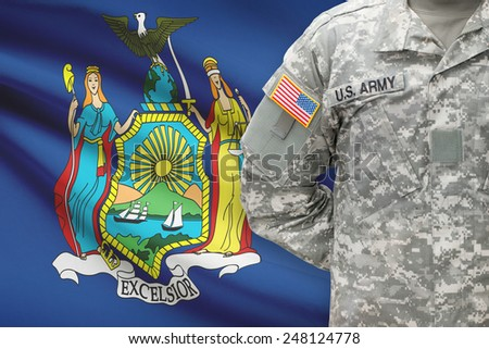 American soldier with US state flag on background - New York - stock photo