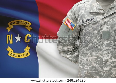American soldier with US state flag on background - North Carolina - stock photo